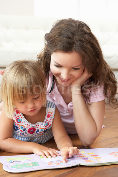 Mother And Daughter Learning To Read At Home Stock photo © monkey_business