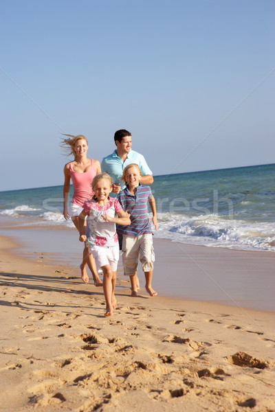 Stock photo: Portrait Of Running Family On Beach Holiday