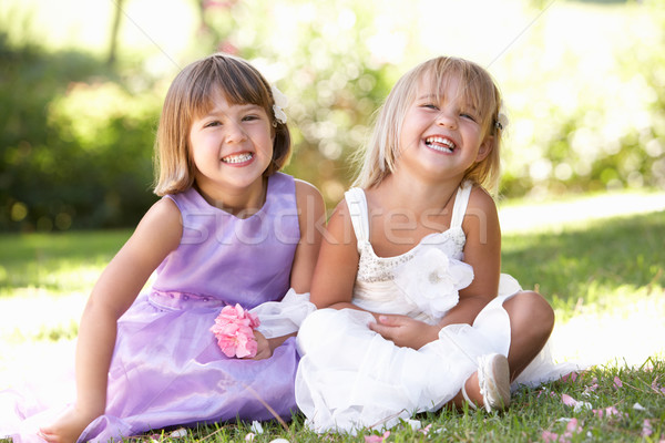Two young girls posing in park Stock photo © monkey_business