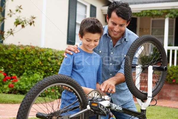 Father and son fixing bike Stock photo © monkey_business