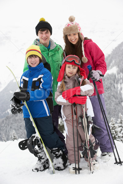 Stock photo: Group Of Children On Ski Holiday In Mountains