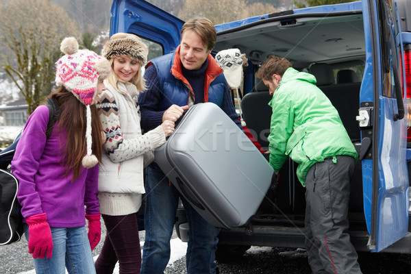 Family Unloading Luggage From Transfer Van Outside Chalet On Ski Stock photo © monkey_business
