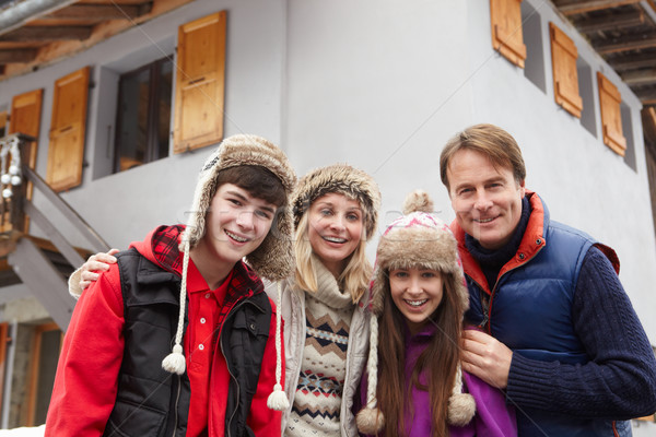 Portrait Of Family Standing Outside Chalet On Ski Holiday Stock photo © monkey_business