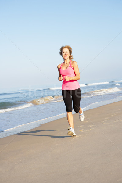 Idős nő testmozgás tengerpart nők tenger Stock fotó © monkey_business