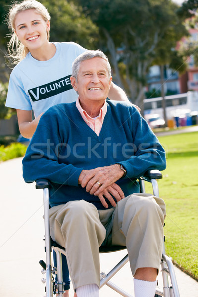 Teenage Volunteer Pushing Senior Man In Wheelchair Stock photo © monkey_business
