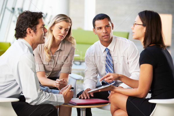 Businesspeople With Digital Tablet Having Meeting In Office Stock photo © monkey_business