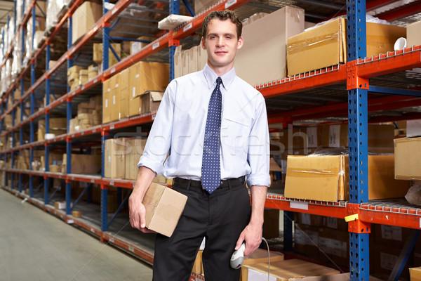 Imprenditore pacchetto scanner magazzino finestra uomini Foto d'archivio © monkey_business