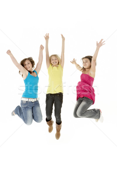 Group Of Three Young Girls Leaping In Air Stock photo © monkey_business