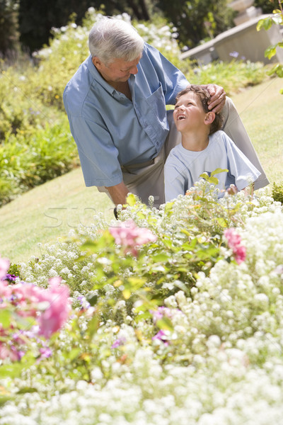 Grandfather and grandson working in the garden Stock photo © monkey_business