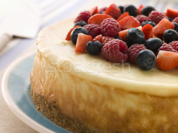 Nueva York tarta de queso mixto bayas frutas tenedor Foto stock © monkey_business