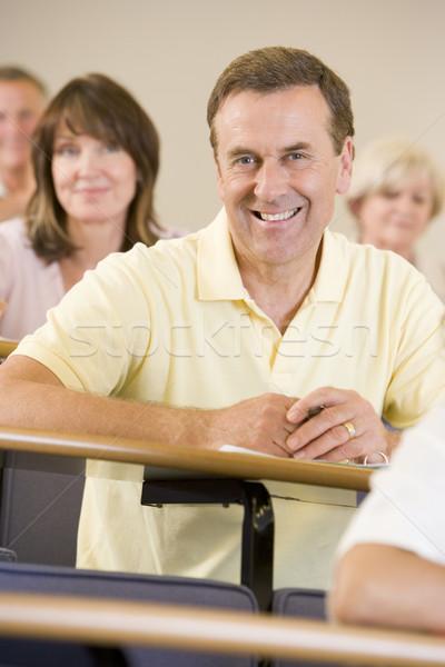Masculina adulto estudiante escuchar Universidad conferencia Foto stock © monkey_business