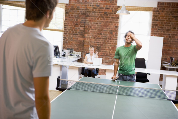 Two men in office space playing ping pong Stock photo © monkey_business