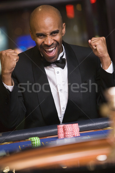 Man winning at roulette table Stock photo © monkey_business