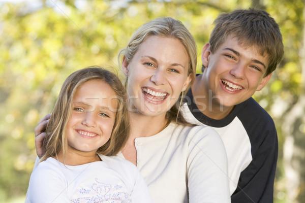 Femme deux jeunes enfants extérieur femme souriante Photo stock © monkey_business