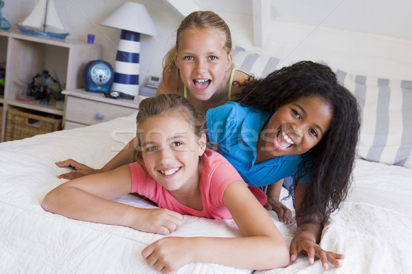 Stock photo: Three Young Friends Lying On Top Of Each Other