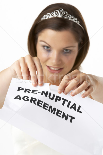 Bride Tearing Up Pre-Nuptial Agreement Stock photo © monkey_business