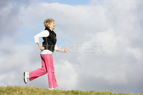 Stockfoto: Senior · vrouw · jogging · park · gelukkig · fitness