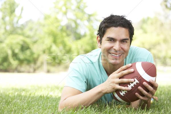 Stockfoto: Portret · jonge · man · park · amerikaanse · voetbal · man