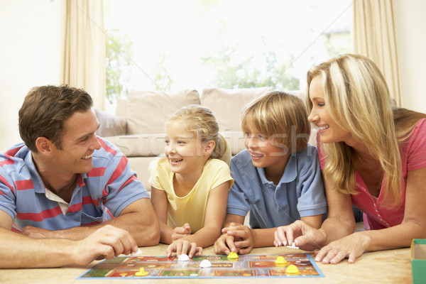 Family Playing Board Game At Home Stock photo © monkey_business
