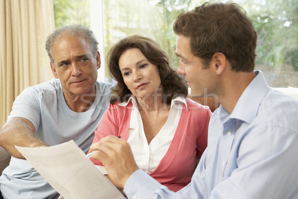 Senior Couple With Financial Advisor At Home Stock photo © monkey_business