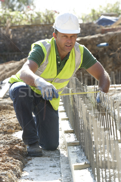 Construction Worker Laying Foundations Stock photo © monkey_business