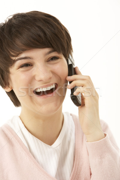 Studio Portrait Of Young Girl Using Mobile Phone Stock photo © monkey_business
