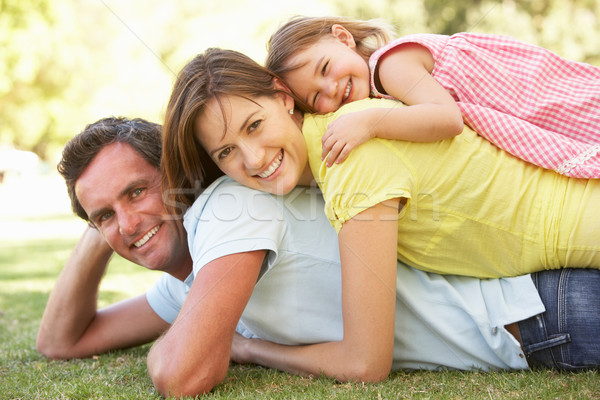 Young Family Relaxing In Park Stock photo © monkey_business