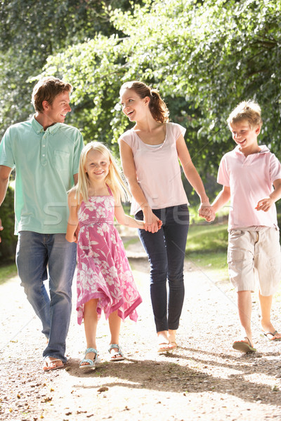 Family Walking In Countryside Together Stock photo © monkey_business