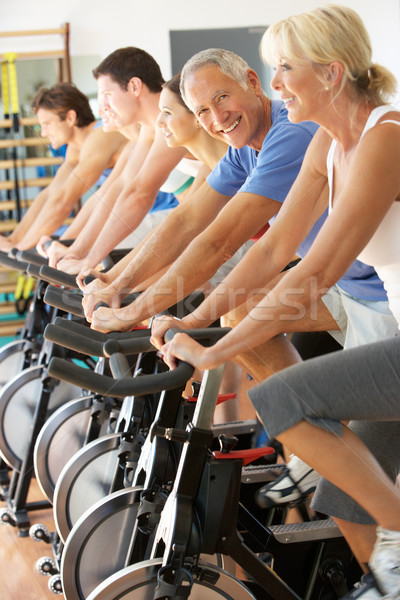 Senior Man Cycling In Spinning Class In Gym Stock photo © monkey_business