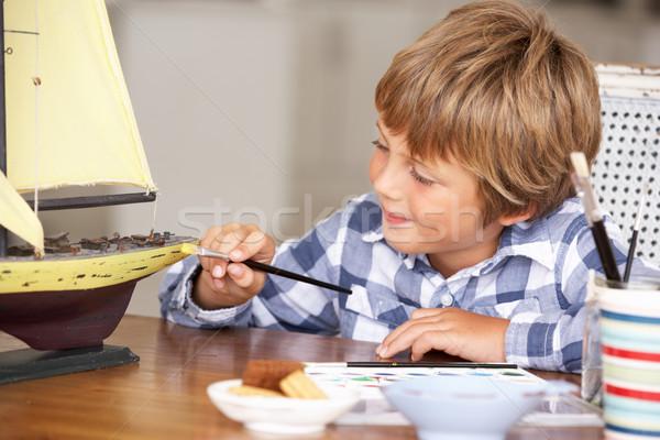 Stock photo: Young boy making model ship