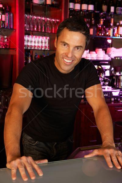 Portrait Of Barman Standing Behind Bar Stock photo © monkey_business