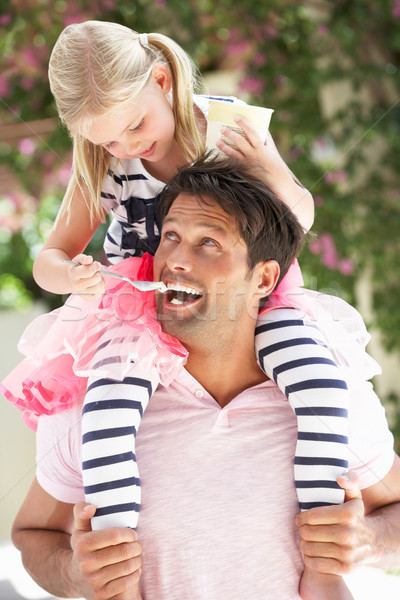 Father Giving Daughter Ride On Shoulders Whilst Being Fed Ice Cr Stock photo © monkey_business