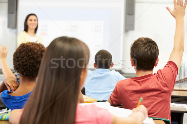 Teacher Standing In Front Of Class Asking Question Stock photo © monkey_business