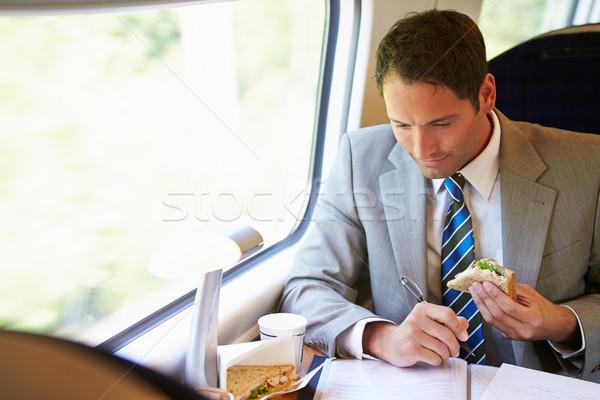 üzletember eszik szendvics vonat utazás étel Stock fotó © monkey_business