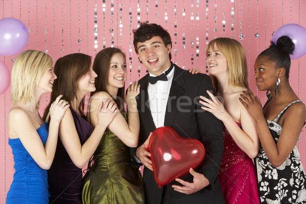 Teenage Girls Looking At Attractive Boy Stock photo © monkey_business