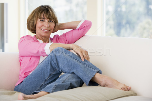 Stock photo: Woman in living room smiling