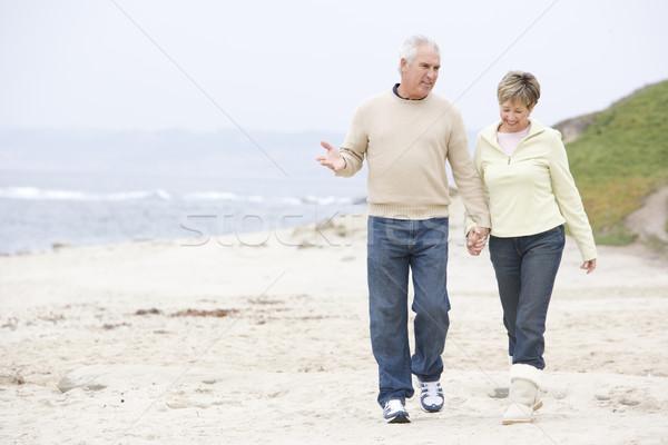 Paar strand holding handen glimlachend vrouw man Stockfoto © monkey_business