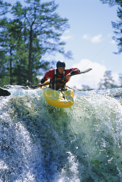 Young man kayaking on waterfall Stock photo © monkey_business
