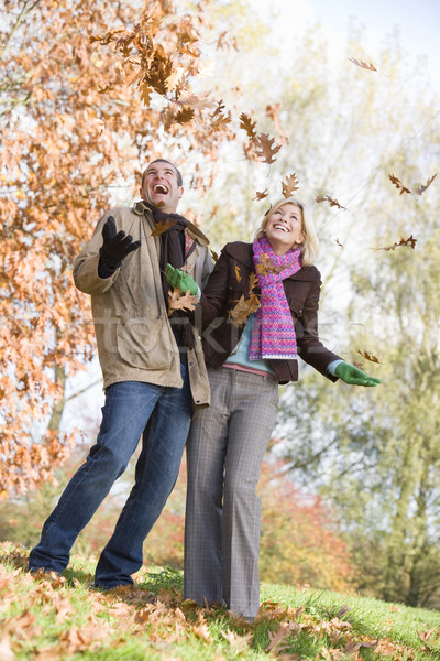 Young couple having fun with autumn leaves Stock photo © monkey_business