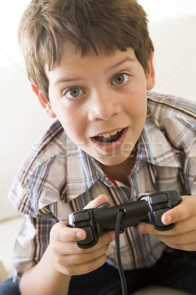 Young boy holding video game controller Stock photo © monkey_business