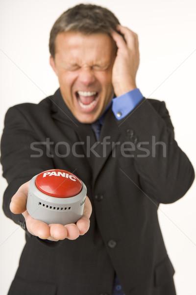 Imprenditore panico pulsante studio colore Foto d'archivio © monkey_business