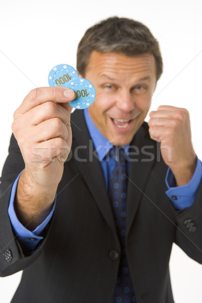 Businessman Holding Poker Chips To The Value Of $2000 Stock photo © monkey_business