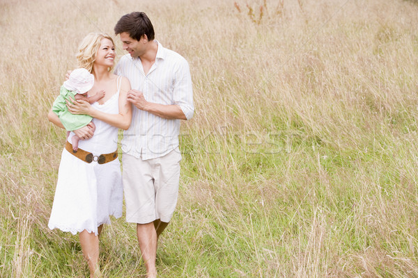 Stock photo: Family walking outdoors smiling