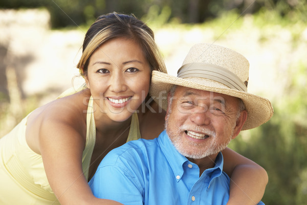 Senior Man With Adult Daughter In Garden Stock photo © monkey_business