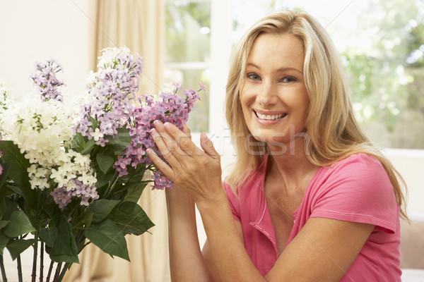 Nő otthon virágok virág boldog nappali Stock fotó © monkey_business
