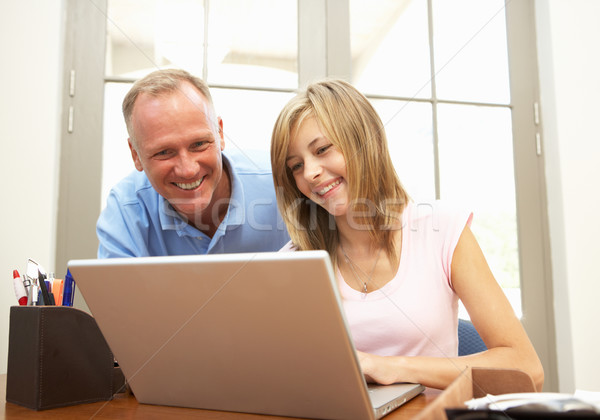 Father And Teenage Daughter Using Laptop At Home Stock photo © monkey_business