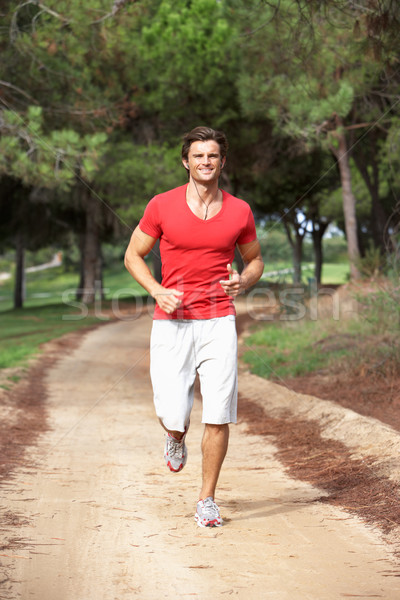 Junger Mann läuft Park Mann glücklich Fitness Stock foto © monkey_business