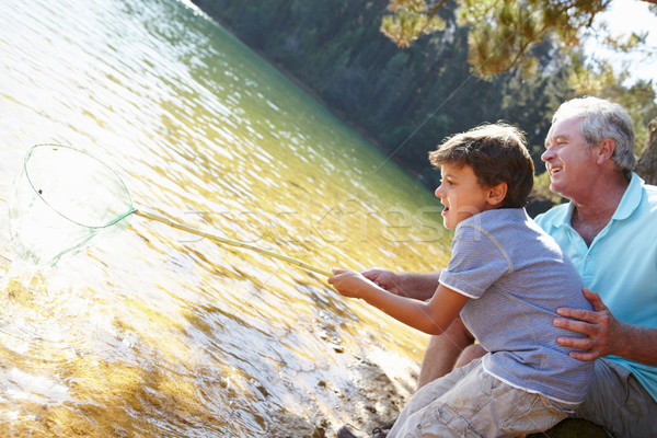 Man and boy fishing together Stock photo © monkey_business