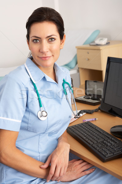 British nurse sitting at desk at work Stock photo © monkey_business