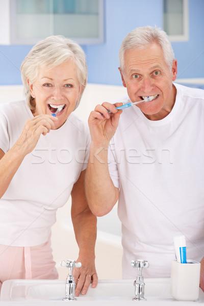 Idős pár fogmosás nő férfi pár portré Stock fotó © monkey_business